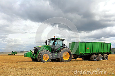 John Deere Tractor and Combine Harvesting Editorial Photo