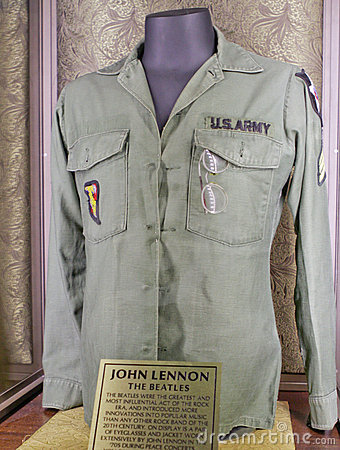 John Lennon s (the Beatles) jacket and eyeglasses Editorial Photo