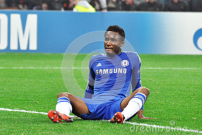 John Obi Mikel is sitting on the field Editorial Photo