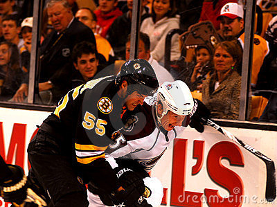 Johnny Boychuk and Cody McLeod battle for the puck Editorial Stock Image