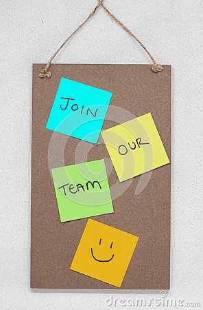 Join our team, text written on colourful sticky notes on a wooden noticeboard Stock Photo