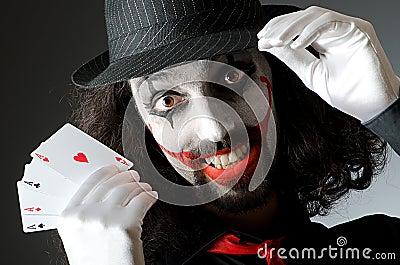 Joker with cards in studio