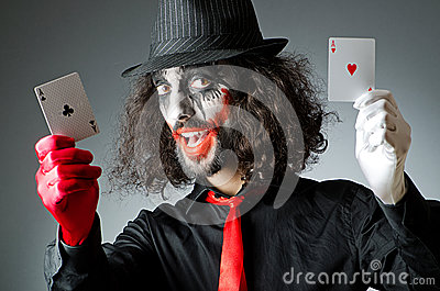 Joker with cards in studio