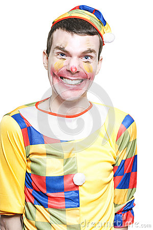 Joker In Clown Costume Laughing At Kids Birthday