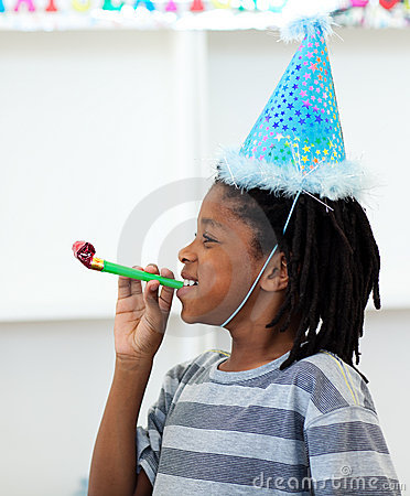 Jolly boy having fun at a birthday party