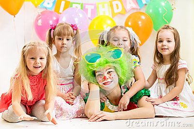 Jolly children and clown on birthday