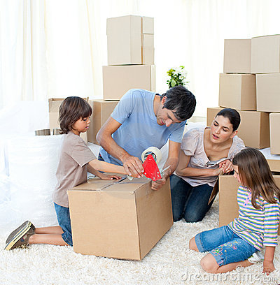 Free Jolly Family Moving House Stock Image - 12401851