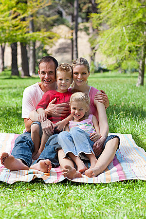 Jolly family at a picnic in a park