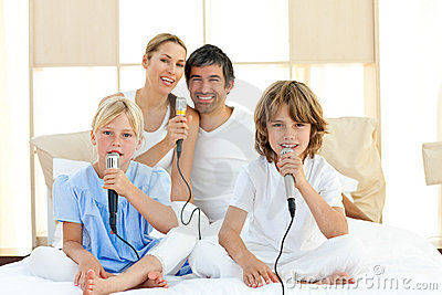 Jolly family singing together Stock Photo