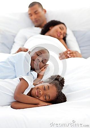Jolly family sleeping