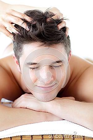 Jolly man receiving a head massage