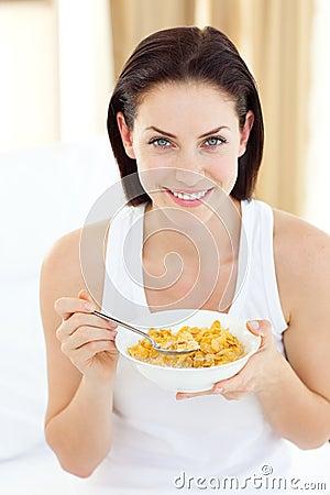 Jolly woman having breakfast