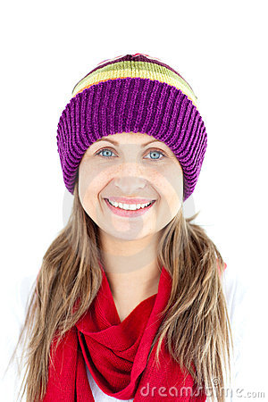 Jolly woman smiling and wearing cap and red scarf