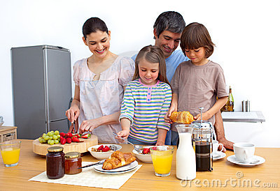 Jolly young family having a breakfast