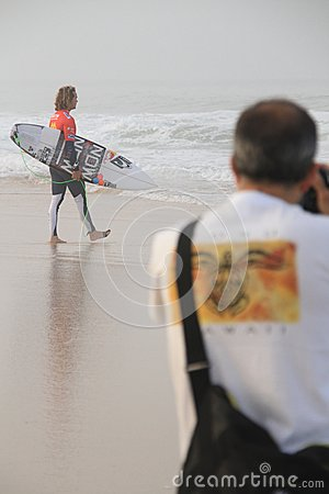 Jordy Smith entering the water Editorial Photo