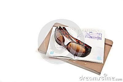 Journal, passport and sunglasses isolated
