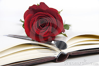 Journal w ith red rose and pen
