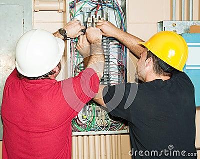 Journeyman Electricians Working