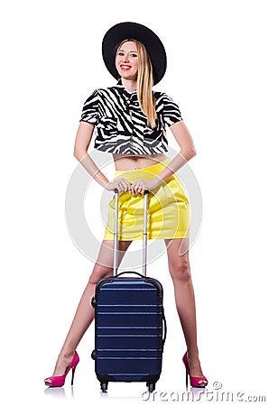 Jovem mulher com mala de viagem