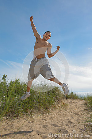 Joyful African American Male Jumping Outdoor