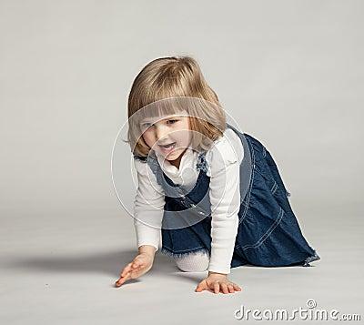 Joyful baby girl sitting on the floor