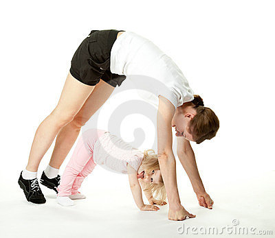 Joyful baby and her mother exercising