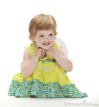 Joyful baby sitting on the floor