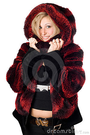 Joyful blond woman in fur jacket
