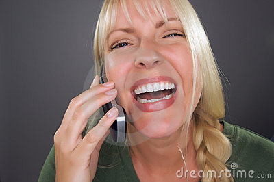 Joyful Blond Woman Using Cell Phone