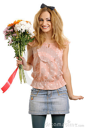Joyful blonde model with a bouquet of flowers