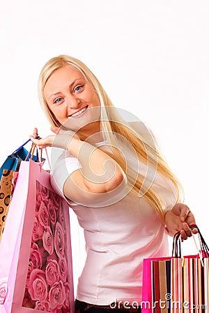 Joyful blonde woman goes shopping