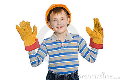 Joyful boy in the construction helmet