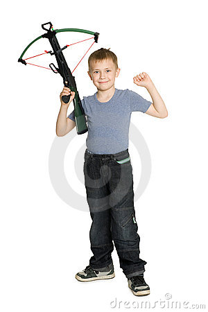 Joyful boy holding a crossbow