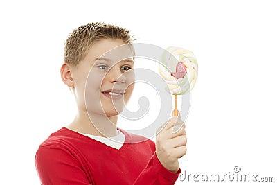 Joyful boy with lollipop