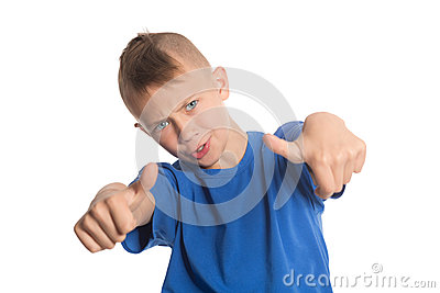 Joyful boy showing thumbs up gesture