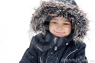 Joyful boy in snowsuit