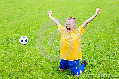 Joyful boy soccer player