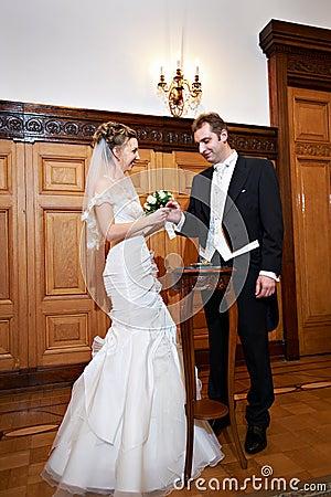 Joyful bride and groom at marriage registration