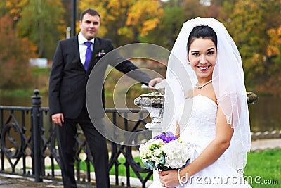 Joyful bride and groom in rainy weather