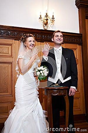 Joyful bride and groom at solemn registration