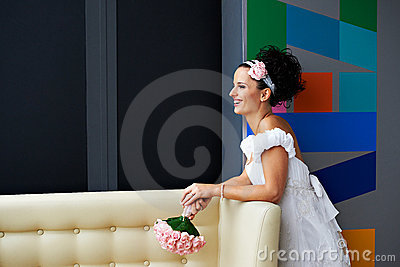 Joyful bride with a wedding bouquet