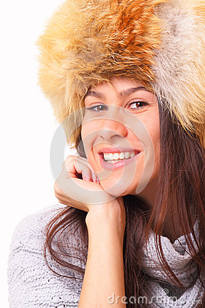 Joyful brunette woman in a fur hat