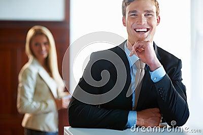 Joyful business man with female executive