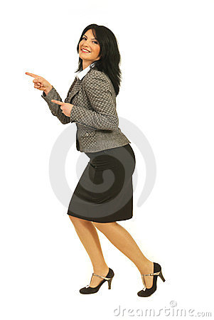 Joyful business woman pointing to left part
