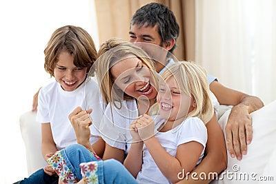 Joyful caucasian family sitting in the living room