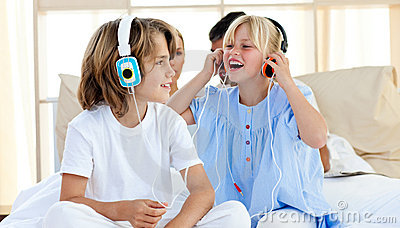 Joyful children having fun and listening music