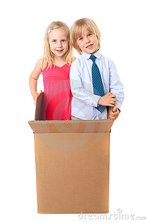 Joyful children look out from a cardboard box
