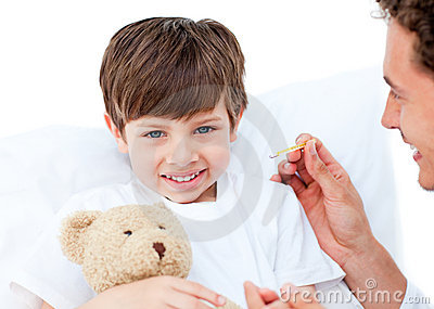 Joyful doctor taking little boy s temperature