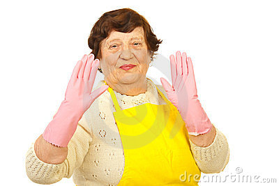 Joyful elderly showing hands in gloves