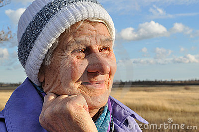 Joyful, an elderly woman